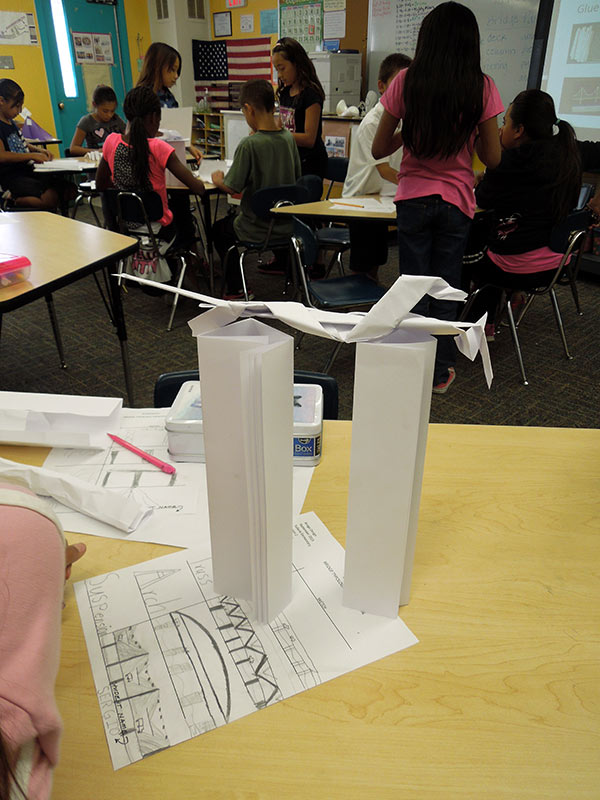 Testing the strength of the paper bridge columns